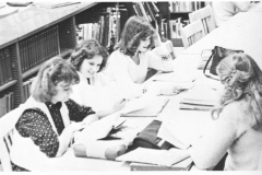 1980 Yearbook pg008 library table full of females
