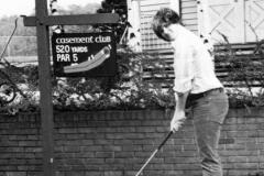 mark gunn with golf club